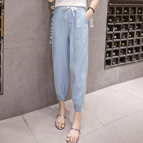 Shiny drawcord ankle tied denim pants