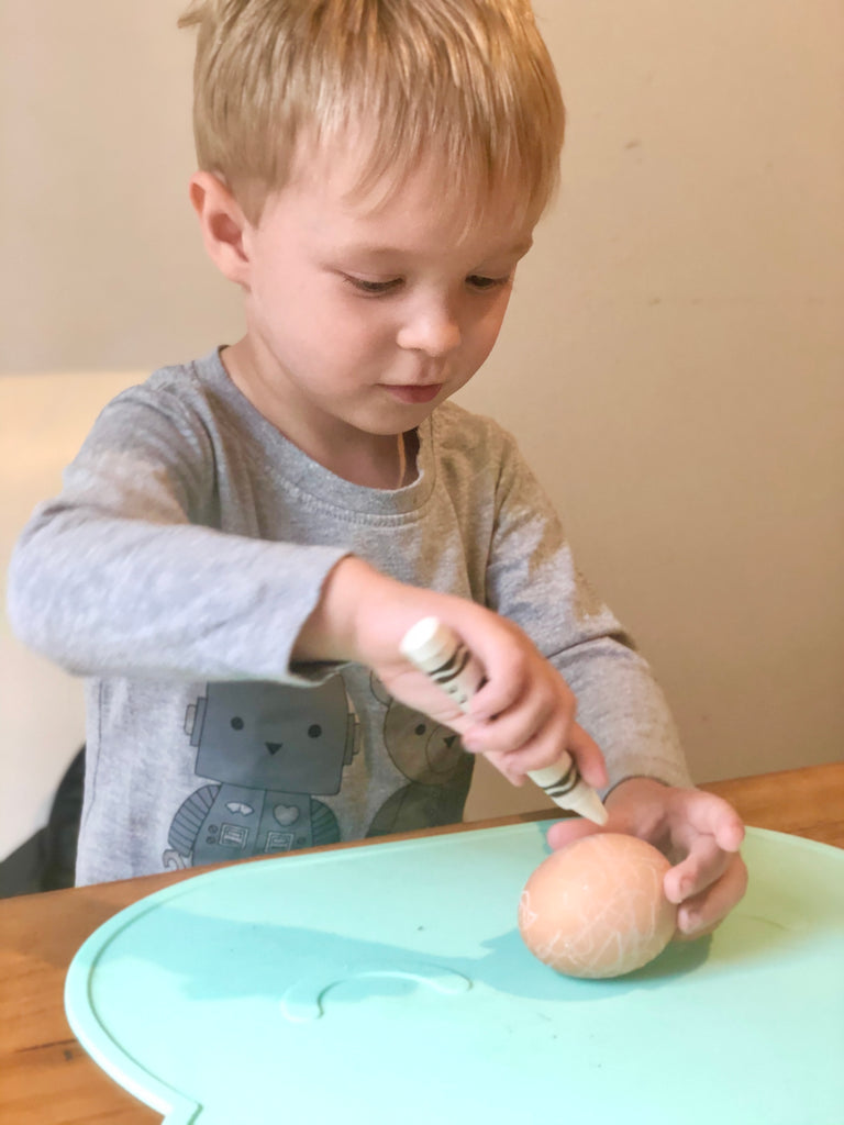 Using crayons on the boiled egg