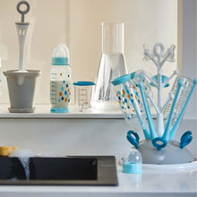 Beaba Tree Draining Rack Blue with bottles drying on kitchen bench