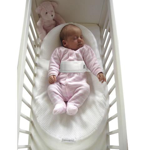 Baby in Cocoonababy® in cot
