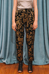 Women's black velvet pants itched with golden rose antique design