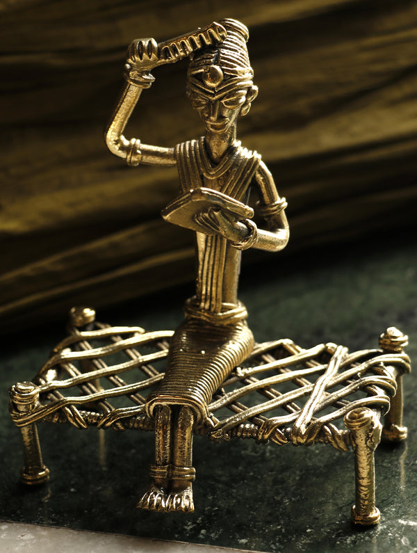 Dhokra Craft Curio - Lady with comb on Bed - The India Craft House