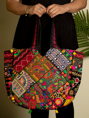 Kutch Patchwork Banjara Large Bag Multicoloured. These are patchwork bags made from embroidered cloth, zari and mirror-work pieces all placed and stitched together to create a vibrant, colourful article of style and utility. Also known as 'Hippie Bags'.