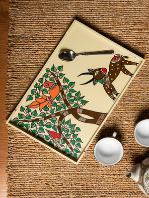 Madhubani Art - Painted Wooden Tray. Hand Painted by Madhubani artisans, this beautiful & unique home artifact is a beautiful curio and a classy way to serve your guests. The origins of Madhubani or Mithila Painting are shrouded in antiquity and mythology.