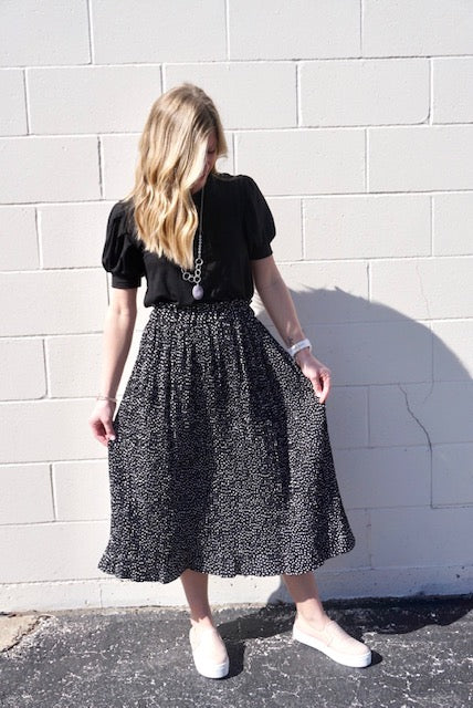 Black spotted midi skirt