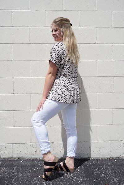 Talia's White distressed denim