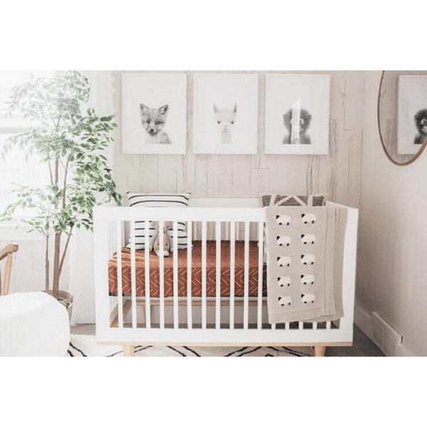 baby nursery with mebie baby rust mudcloth crib sheet