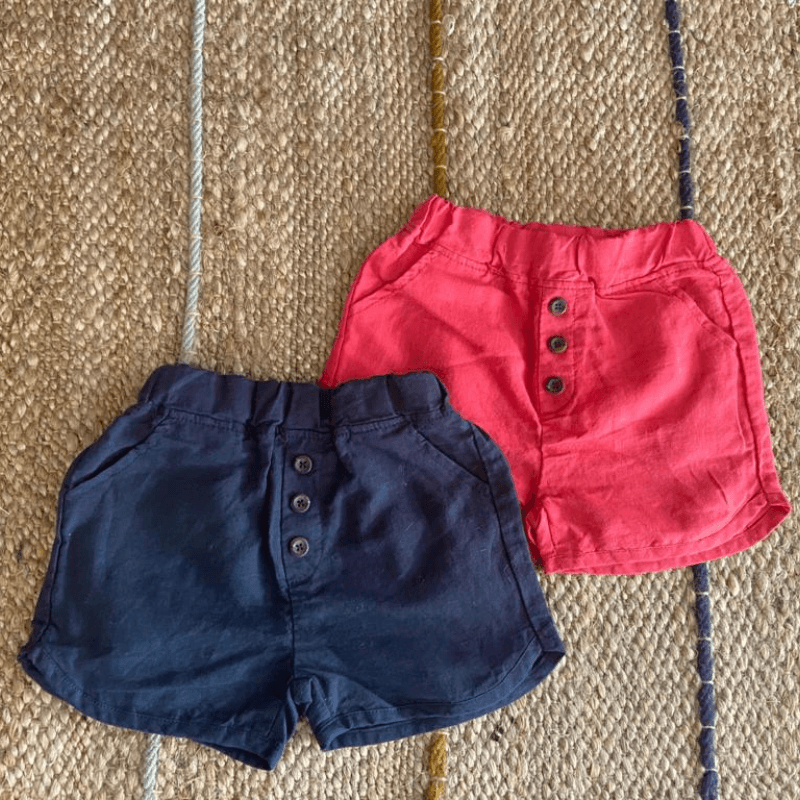 button shorts in red