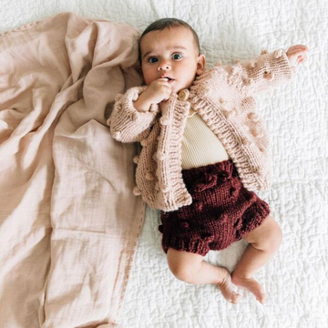 knit bloomers in pomegranate for baby girls