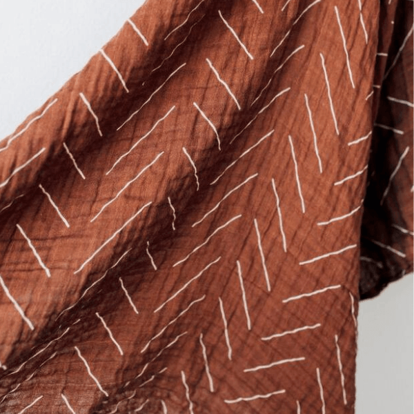 mebie baby cotton muslin swaddle, rust mud cloth chevron print