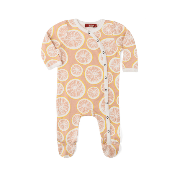 organic footed romper in grapefruit