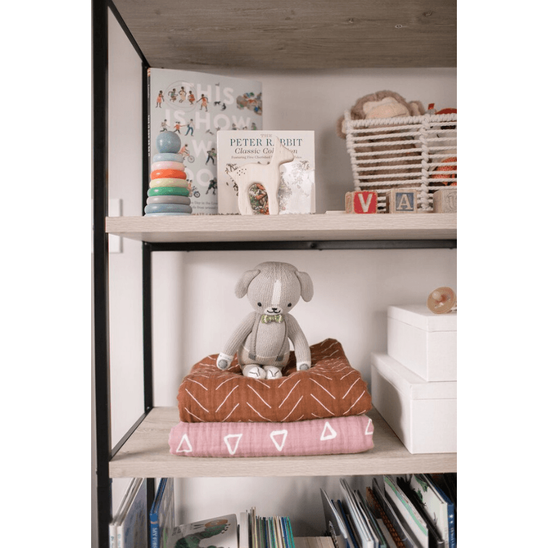 nursery shelf with folded mebie baby blush triangle quilt