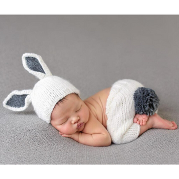 sleeping baby wearing bailey bunny newborn set, white and grey