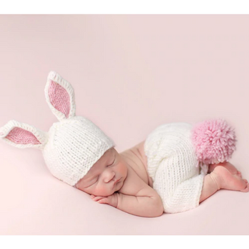 sleeping baby wearing bailey bunny newborn set, white and pink