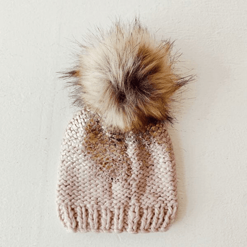 the blueberry hill pearl metallic hat with fur pom, blush/gold