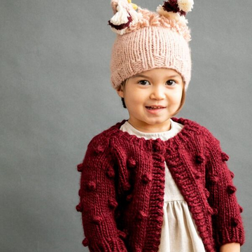 the blueberry hill popcorn sweater in pomegranate for baby and toddler girls