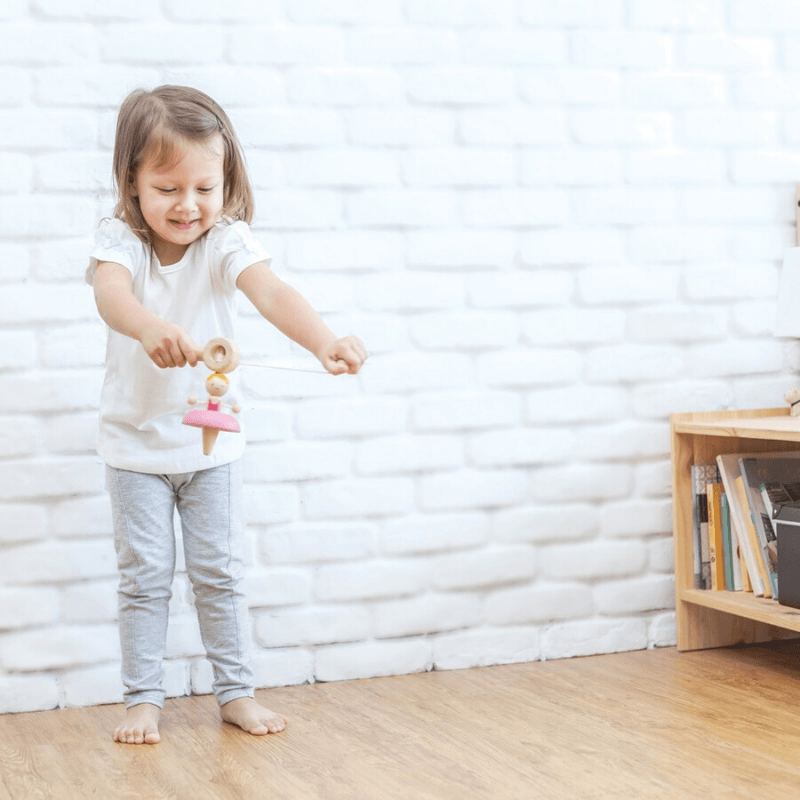 toddler girl playing with ballerina top