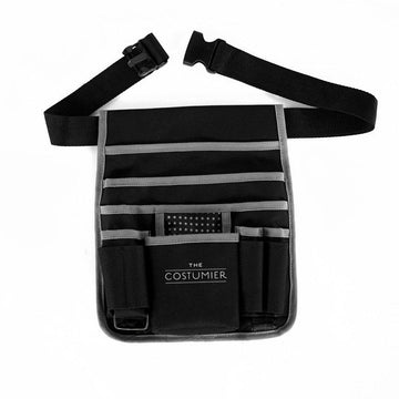 The Costumier Waist Bag - Specifically for costumiers, stylists, dressers and standbys, this small waist bag offers quick and easy access on set.  The Costumier Waist Bag is made from strong hardwearing fabric with several compartments, pouches and pockets designed to hold all of your essentials.  A handy D ring to hang safety pins or similar off of. A webbing loop to hang your specifics from and adjustable waist belt.