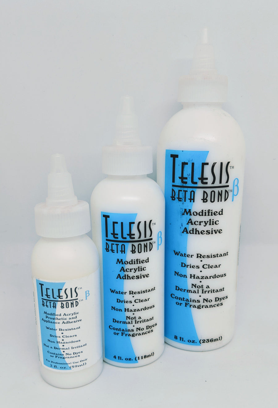 PPI Telesis Beta Bond - Similar to Pros-Aide - clear drying, non flammable, great for prosthetic appllication. Alternative to silicone glues. Some experts prefer beta bond to prosaide, don't forget beta bond plus - which is stronger, tackier and a bit more pliable. Both can be removed with beta solve... double bonding helps to increase the bond.