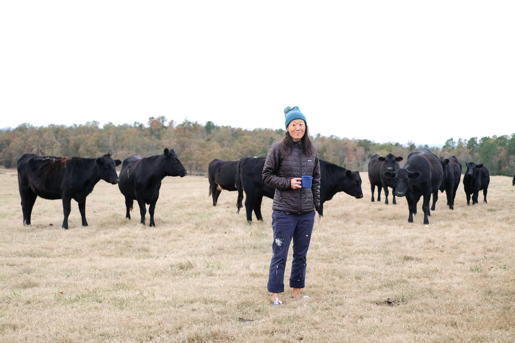 Erin drinking coffee with the cows