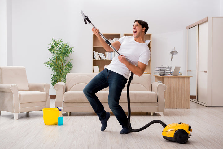 man cleaning home happily
