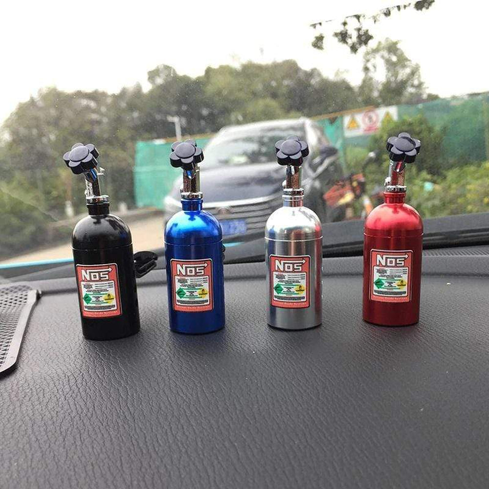 NOS Bottle Car Air Freshener and perfume in black, blue, silver, and red. Strawberry, Grapes, Lemon, and grapefruit scents.