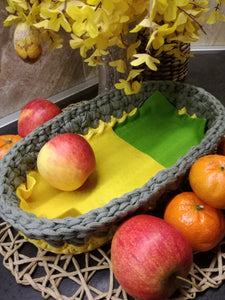Crochet basket oval yellow/gun metal color made out of T-shirt yarn and with wooden bottom