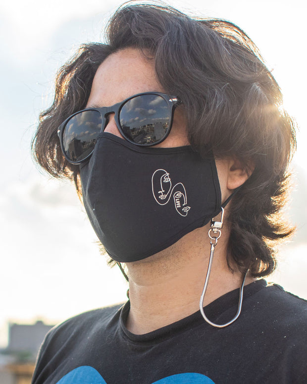 Man using face mask chain holder with his mask around the neck