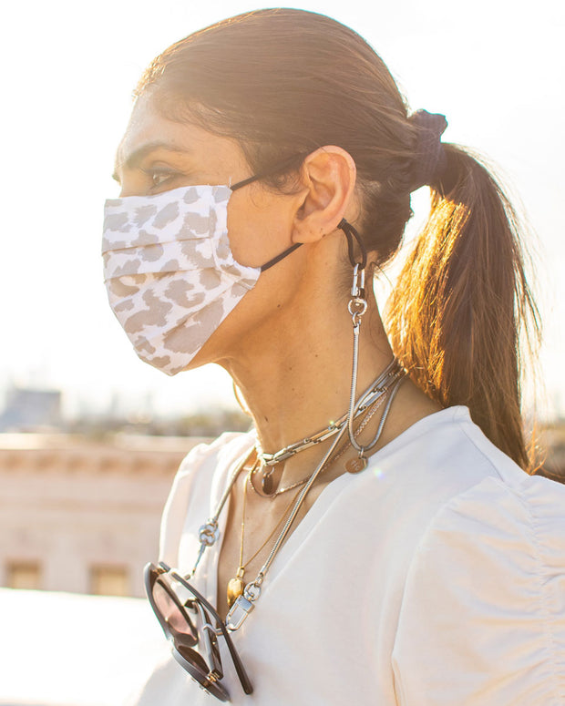 Girl using Charlie snake chain as a mask holder around the neck and with sunglasses