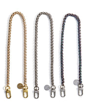 Product shot of gold, silver, and rainbow irridecent face mask chain necklace holders