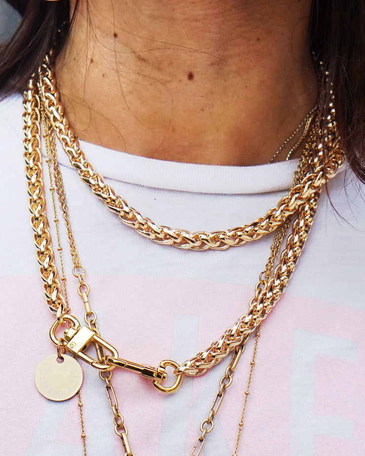 The Nikki gold long chain being worn as a stylish, modern necklace