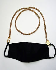 Product shot on white with our long gold face mask chain holder attached to a black mask