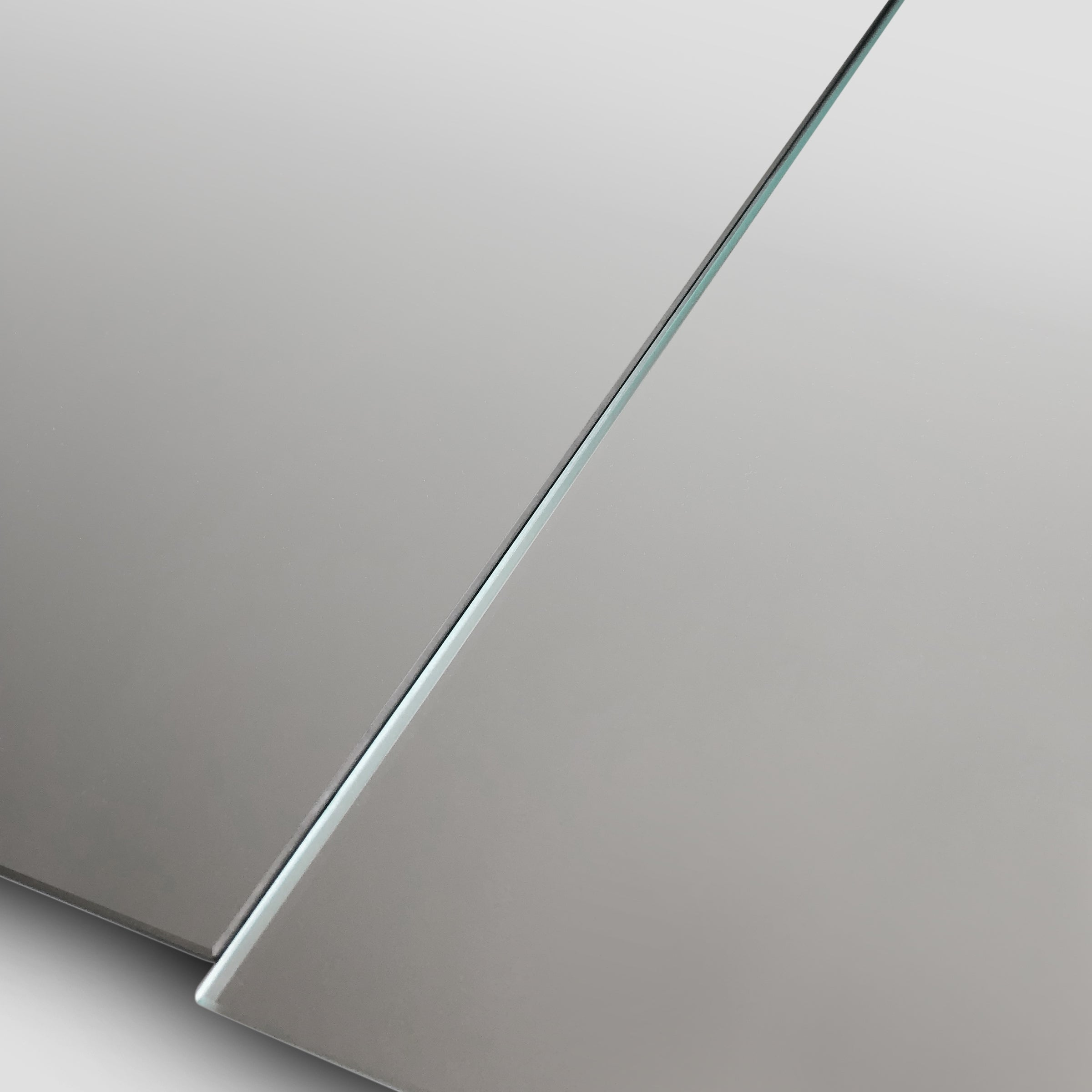 Detail view of the modern minimalist ICEBERG mirror, clear mirror mounted on MDF panel, available in two practical dimensions, easy mounting using a pair of d-hooks, designed and made in Montreal Canada.