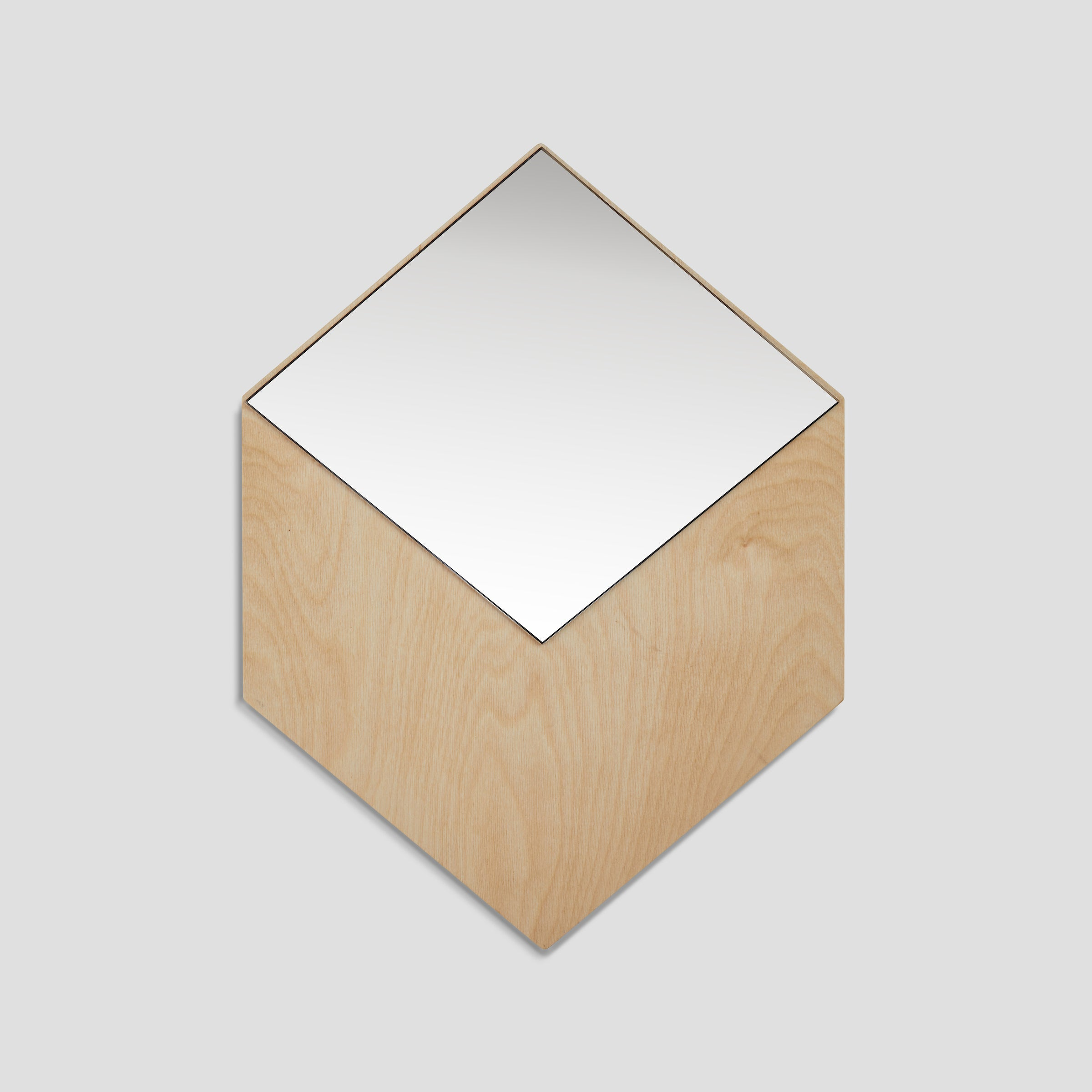 Front view of the modern minimalist CUBO mirror, bronze mirror mounted on a baltic birch plywood shaped as a three dimensional cube, available in two practical dimensions, easy mounting using keyhole slots, all mounting hardware included, designed and made in Montreal Canada.