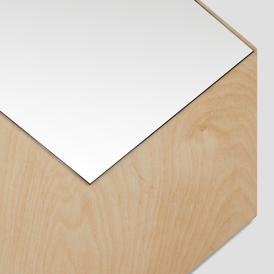 Detail view of the modern minimalist CUBO mirror, bronze mirror mounted on a baltic birch plywood shaped as a three dimensional cube, available in two practical dimensions, easy mounting using keyhole slots, all mounting hardware included, designed and made in Montreal Canada.