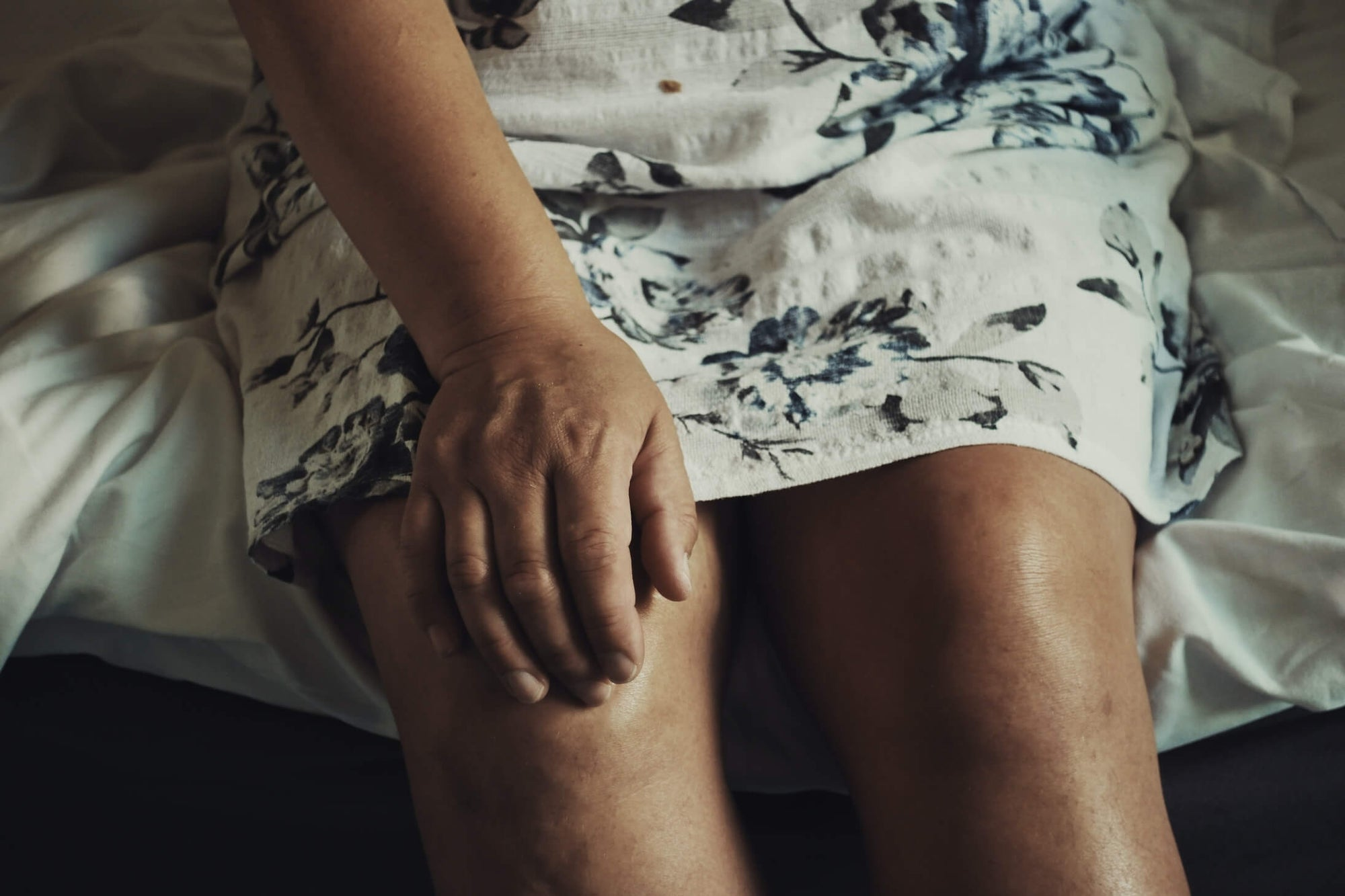 Woman holding her knee from joint pain