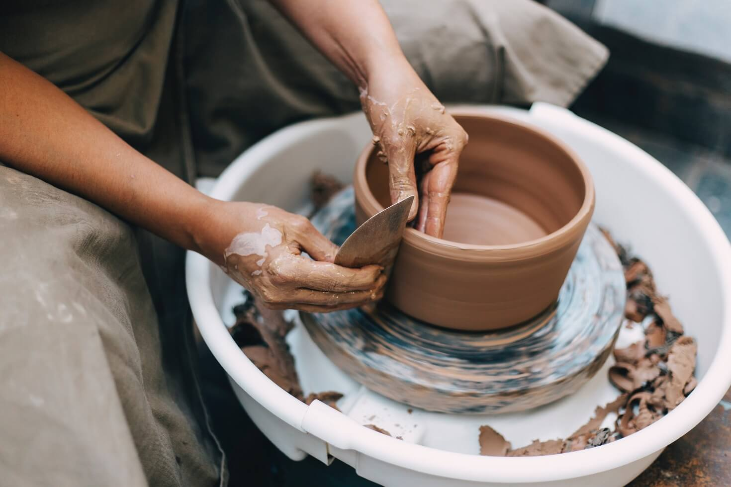 Person making clay ceramics as a form of art therapy