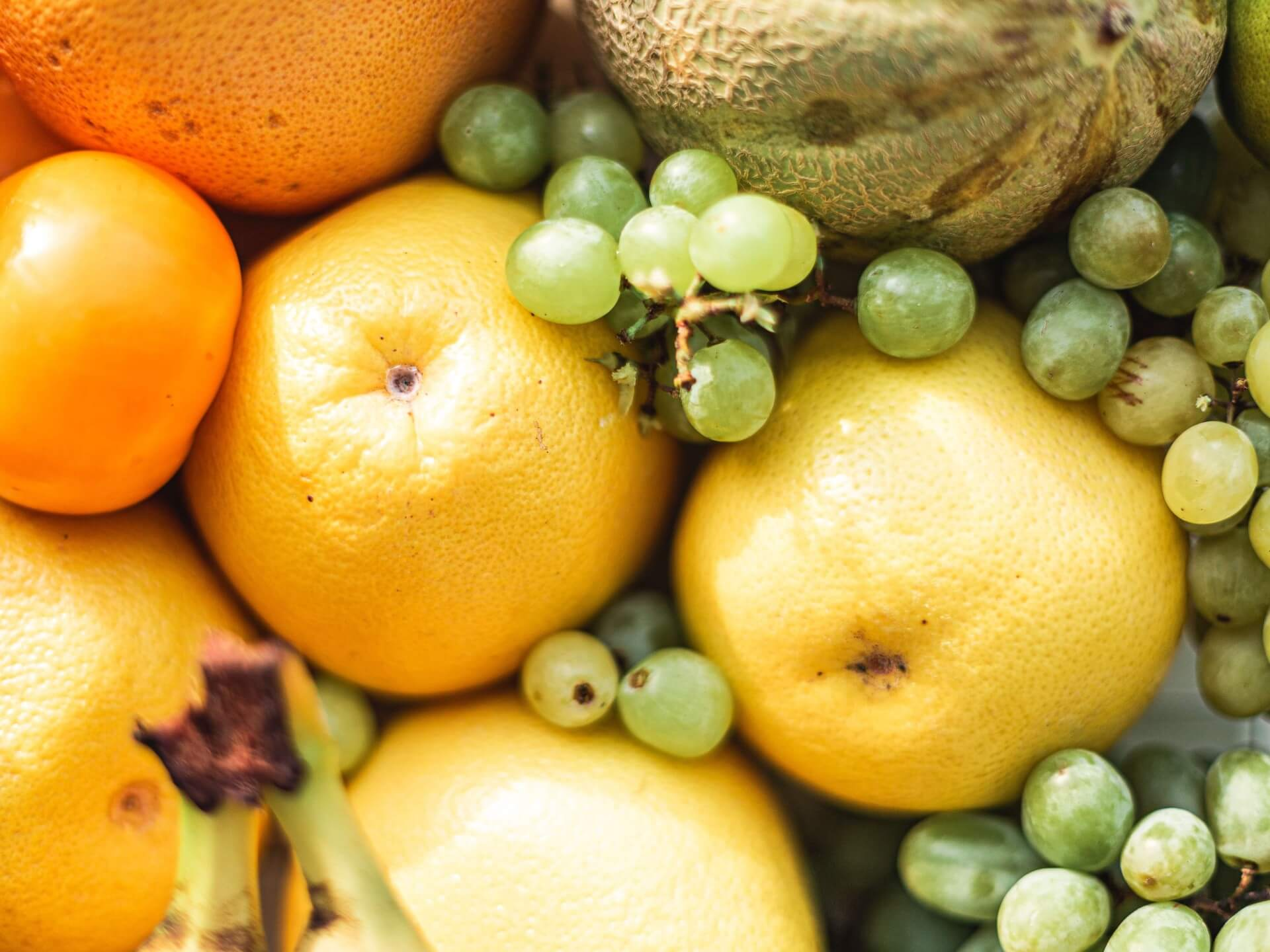 Photo of grapefruit, grapes, oranges, and melons