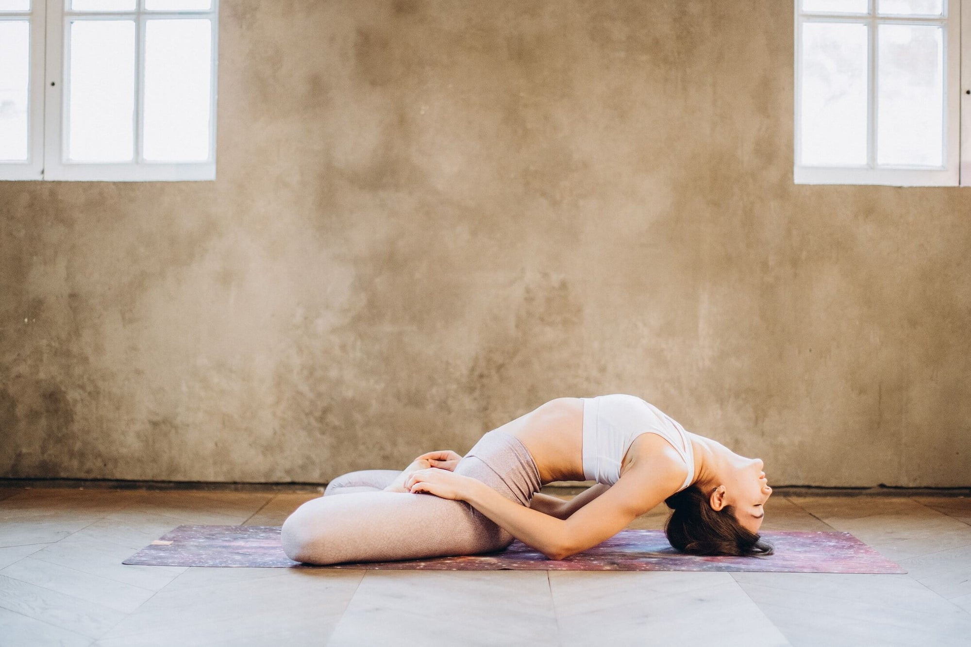 Woman in yoga pose for digestion