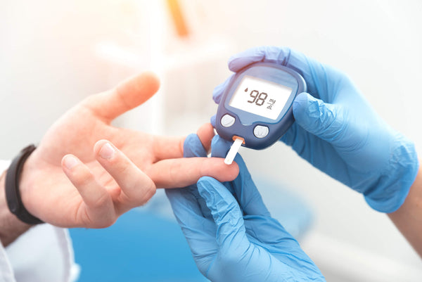 Person with diabetes getting their glucose levels measured