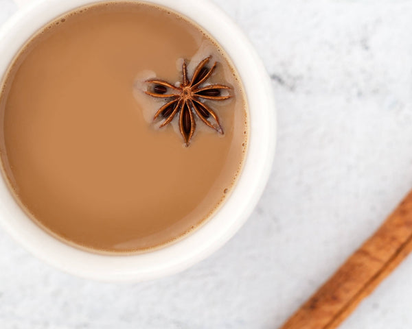 Cup of star anise and cinnamon sticks in chai tea