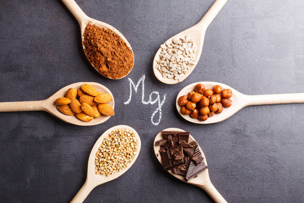 Good sources of magnesium on spoons including chocolate and oats