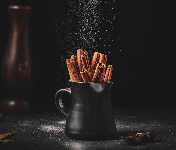 Cinnamon sticks in a black mug