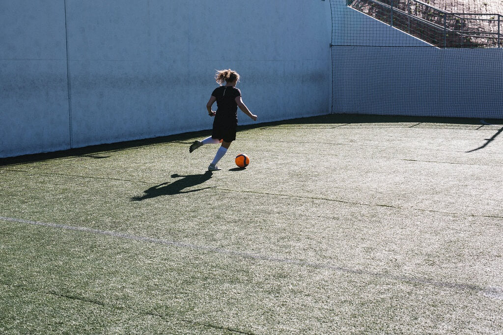 Woman playing soccer for heart-healthy aerobic exercise