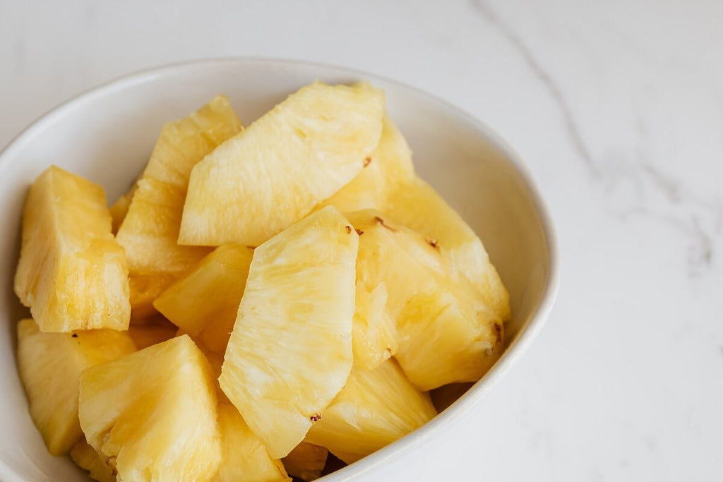Bowl of pineapple on a white countertop
