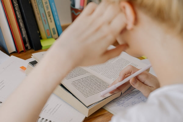 Child reading a book for school