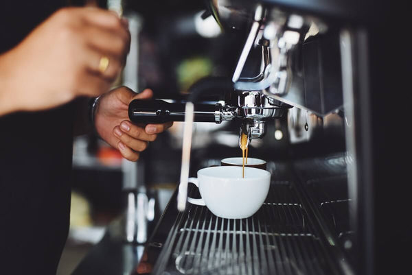 Photo of barista using an espresso machine