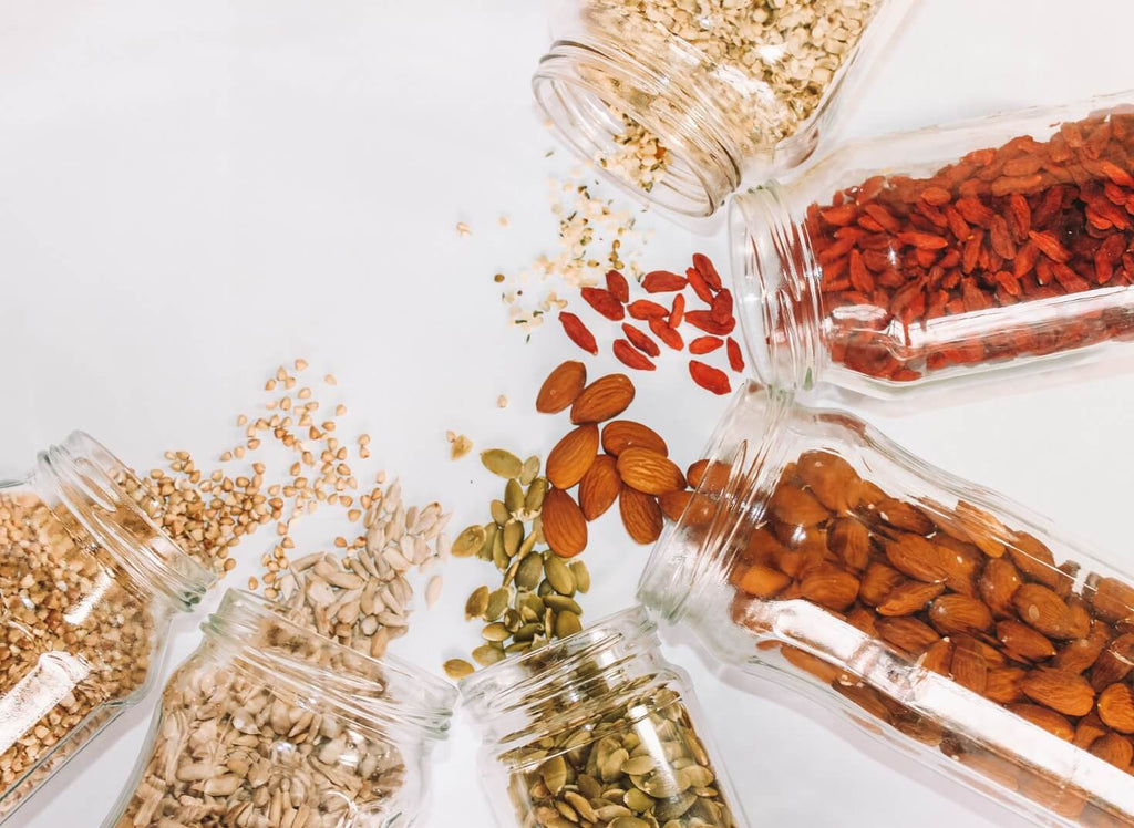 Grains and seeds in jars on a countertop for spring cleaning