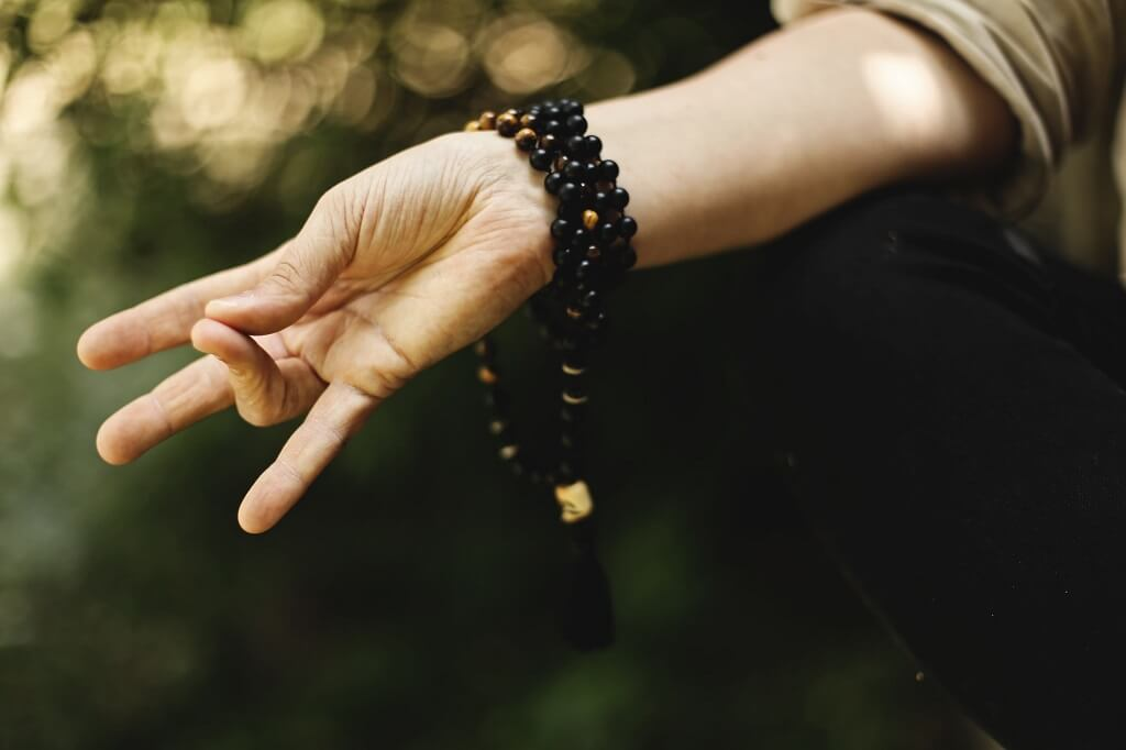 Hands of a woman meditating outside