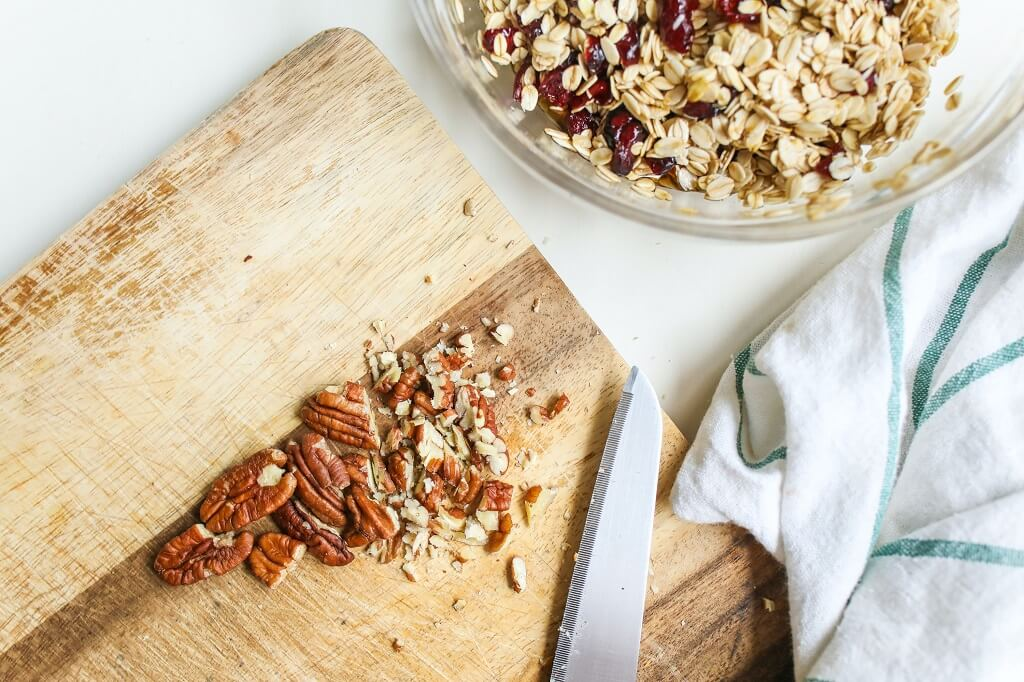 Pecans on a cutting board to add to muesli for breakfast